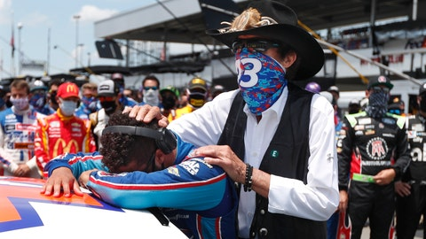 <p>               NASCAR driver Bubba Wallace is consoled by team owner Richard Petty, right, prior to the start of the NASCAR Cup Series at the Talladega Superspeedway in Talladega, Ala., Monday, June 22, 2020. In an extraordinary act of solidarity with Wallace, NASCAR's only Black driver, dozens of drivers pushed his car to the front of the field before Monday's race. (AP Photo/John Bazemore)             </p>