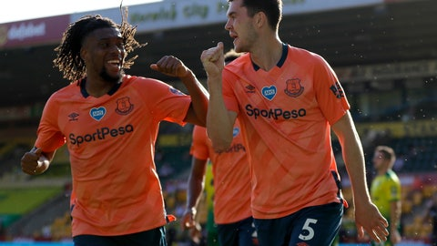 <p>               Everton's Michael Keane, right, and Everton's Alex Iwobi celebrate scoring their side's first goal during the English Premier League soccer match between Norwich and Everton at Carrow Road Stadium in Norwich, England, Wednesday, June 24, 2020. (AP photo/Kirsty Wigglesworth, Pool)             </p>