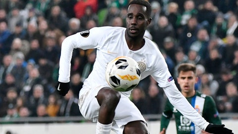 """<p>               FILE - In this Thursday, Nov. 28, 2019 file photo, Tokmac Nguen of Ferencvaros in action during the soccer Europa League Group H fifth round soccer match Ferencvaros vs. Espanyol at the Groupama Arena in Budapest, Hungary. The Hungarian soccer federation has issued a written reprimand to a player of African origin who showed his undershirt with the words """"Justice for George Floyd"""" after scoring a goal. Tokmac Nguen was born in a refugee camp in Kenya to parents from South Sudan and grew up in Norway. He scored for Ferencvaros in its 1-1 draw with Puskas Akademia on Sunday, May 31, 2020.  (Zsolt Szigetvary/MTI via AP, File)             </p>"""