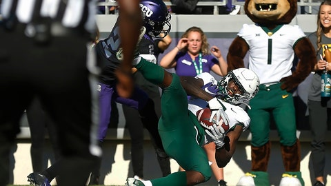 <p>               FILE - In this Nov. 9, 2019, file photo, Baylor wide receiver Denzel Mims (5) catches a touchdown pass as TCU cornerback Kee'yon Stewart (2) defends during the third overtime of an NCAA college football game in Fort Worth, Texas. Mims was selected by the New York Jets in the second round of the NFL football draft Friday, April 24, 2020. (AP Photo/Ron Jenkins, File)             </p>