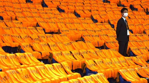 <p>               A man stands at the empty seats with orange color jerseys prior to an opening baseball game between the Yomiuri Giants and the Hanshin Tigers at Tokyo Dome in Tokyo Friday, June 19, 2020. Japan's professional baseball regular season will be kicked off Friday without fans in attendance because of the threat of the spreading coronavirus. (AP Photo/Eugene Hoshiko)             </p>