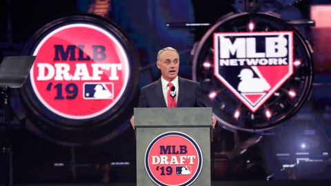 <p>               FILE - In this June 3, 2019, file photo, Baseball Commissioner Rob Manfred speaks during the first round of the baseball draft in Secaucus, N.J. Baseball's amateur draft this week will look much different because of the coronavirus pandemic, and more permanent changes could be coming soon. (AP Photo/Julio Cortez, File)             </p>