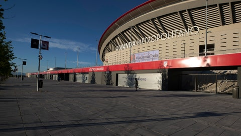 <p>               A man jogs past Atletico Madrid's Wanda Metropolitano stadium in Madrid, Spain, Tuesday, May 5, 2020. The Spanish soccer league aims to restart in June without spectators. It's new compulsory protocols say all players, coaches and club employees must be tested for COVID-19 coronavirus before training resumes, then regularly after that. All clubs' training facilities must be properly prepared and disinfected before players can start practicing individually. (AP Photo/Paul White)             </p>