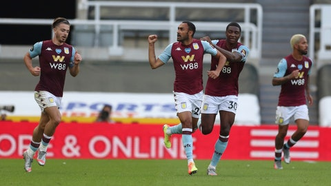 <p>               Aston Villa's Ahmed Elmohamady, second left, celebrates after scoring his side's opening goal during the English Premier League soccer match between Newcastle United and Aston Villa at St James' Park stadium in NewCastle, England, Wednesday, June 24, 2020. (Lee Smith/Pool via AP)             </p>
