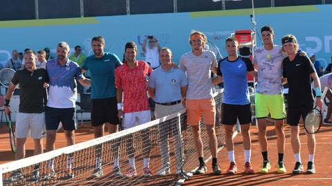 <p>               In this photo taken June 19, 2020, Serbian tennis player Novak Djokovic, fourth left, poses with other players at a tournament in Zadar, Croatia. Novak Djokovic has tested positive for the coronavirus after taking part in a tennis exhibition series he organized in Serbia and Croatia. (AP Photo/Zvonko Kucelin)             </p>