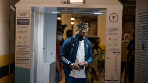 <p>               Flamengo's Gabriel Barbosa passes through a body scanner as he arrives at the Maracana stadium to play a Rio de Janeiro soccer league match against Bangu in Rio de Janeiro, Brazil, Thursday, June 18, 2020. Rio de Janeiro's soccer league resumed after a three-month hiatus because of the coronavirus pandemic. The match is being played without spectators to curb the spread of COVID-19. (AP Photo/Leo Correa)             </p>