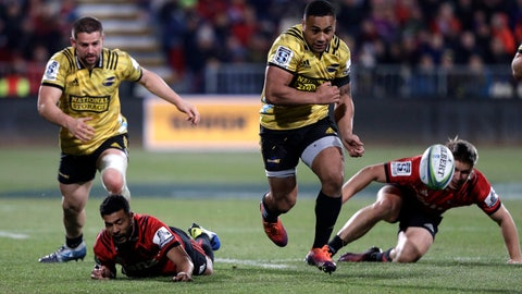 <p>               FILE - In this June 29, 2019, file photo, Hurricanes Ngani Laumape kicks the ball down field during the Super Rugby semifinal between the Crusaders and the Hurricanes in Christchurch, New Zealand. The cheers of the crowd will resound in New Zealand sports stadiums for the first time in months with more than 50,000 people expected to attend matches in the opening round of Super Rugby Aotearoa. More than 18,000 are expected at the first match in the New Zealand professional rugby tournament in Dunedin on Saturday, June 13, 2020 between the Highlanders and the Hamilton-based Chiefs. (AP Photo/Mark Baker,File)             </p>