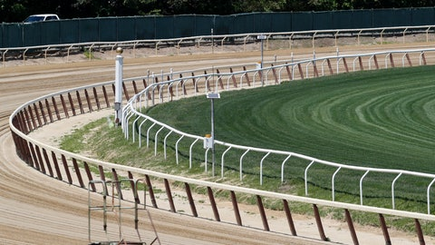 <p>               The far turn at Belmont Race Track is empty of action, Wednesday, May 27, 2020, in Elmont, N.Y. The track is the site of the Belmont Stakes race, usually the third leg of horse racing's Triple Crown. This year, however, due to concerns over the spread of the coronavirus, the race will be held as the first leg of the Triple Crown, and no spectators will be allowed. The race was rescheduled from early June to June 20, 2020. (AP Photo/Kathy Willens)             </p>