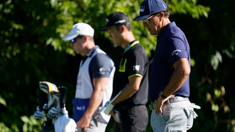 <p>               Phil Mickelson, right, Kevin Na, center, and their caddie observe a moment of silence not the 13th tee during the first round of the Charles Schwab Challenge golf tournament at the Colonial Country Club in Fort Worth, Texas, Thursday, June 11, 2020. Players at the 8:46 a.m. tee time paused to pay their respects to the memory of George Floyd for a moment of silence, prayer and reflection. (AP Photo/David J. Phillip)             </p>