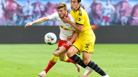 <p>               Leipzig's Timo Werner, left, and Dortmund's Giovanni Reyna fight for the ball during the German Bundesliga soccer match between RB Leipzig and Borussia Dortmund in Leipzig, Germany, Saturday, June 20, 2020. (AP Photo/Jens Meyer, Pool)             </p>