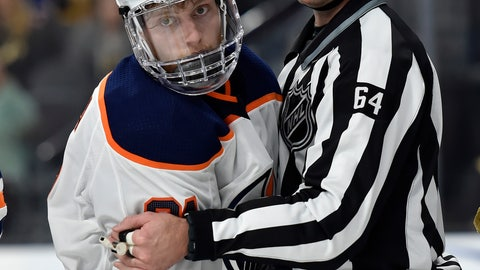 <p>               FILE - In this Feb. 15, 2018, file photo, Edmonton Oilers center Drake Caggiula is held by linesman Brandon Gawryletz during the third period of the Oilers' NHL hockey game against the Vegas Golden Knights in Las Vegas. Because NHL players are expected to be tested daily, there isn't expected to be additional on-ice equipment required for practices and games. Deputy Commissioner Bill Daly additionally said he didn't anticipate any mandatory equipment changes to ensure player safety. Still, hockey equipment manufacturer Bauer has spoken with the league and teams about medical-grade off-ice visors that coaches, executives, team personnel and others could wear as a measure of protection against spreading or contracting COVID-19. (AP Photo/David Becker, File)             </p>