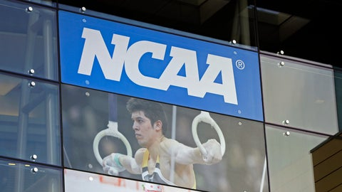 """<p>               FILE - In this April 25, 2018, file photo, the NCAA headquarters is shown in Indianapolis. More than a dozen national associations in various sports – hockey, soccer, tennis, golf, swimming and gymnastics, among them – have signed a memo outlining """"significant concerns"""" about effects of allowing athletes to profit for use of their names, images and likenesses (NIL). (AP Photo/Darron Cummings, File)             </p>"""