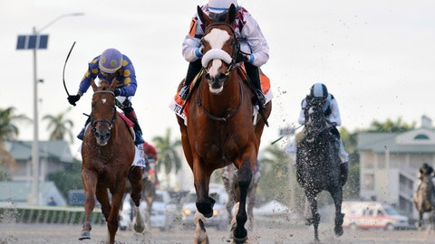 <p>               In this March 28, 2020, image provided by Gulfstream Park, Tiz the Law, riddren by Manuel Franco, foreground, runs in the Florida Derby horse race at Gulfstream Park in Hallandale Beach, Fla. Tiz the Law looks every bit like the best 3-year-old in the world and is the Triple Crown favorite, so it'll take something spectacular from a watered-down field to prevent him from becoming the first New York-bred horse to win the Belmont in over 130 years and take a powerful stride toward the Kentucky Derby. (Ryan Thompson/Coglianese Photos, Gulfstream Park via AP)             </p>