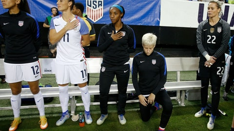 <p>               FILE - In this Sept. 18, 2016, file photo, United States' Megan Rapinoe, right, kneels next to teammates Christen Press (12), Ali Krieger (11), Crystal Dunn (16) and Ashlyn Harris (22) as the national anthem is played before the team's exhibition soccer match against the Netherlands in Atlanta. The U.S. women's national team wants the U.S. Soccer Federation to repeal the anthem policy it instituted after Rapinoe started kneeling during the national anthem. The U.S. women's team also wants the federation to state publicly that the policy was wrong and issue an apology to the team's black players and supporters. (AP Photo/John Bazemore, File)             </p>