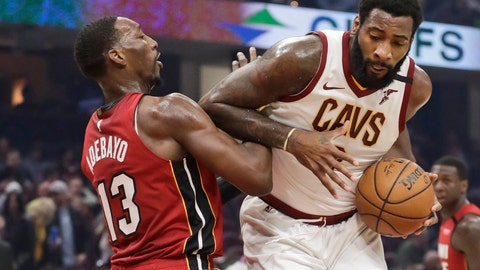 <p>               FILE - Cleveland Cavaliers' Andre Drummond, right, drives past Miami Heat's Bam Adebayo in the first half of an NBA basketball game, in Cleveland. Cavaliers center Andre Drummond said he'll exercise his $28.7 million option for the 2020-21 season and stay with Cleveland. (AP Photo/Tony Dejak, File)             </p>
