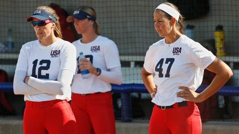 <p>               FILE - In this Oct. 2, 2019, file photo, pitchers Monica Abbott, left, and Cat Osterman, right, watch during the USA Softball Women's Olympic Team Selection Trials in Oklahoma City. The Scrap Yard Dawgs, one of America's top pro women's softball teams, continue to suffer fallout from a controversial post on the team's Twitter account. Dawgs players Cat Osterman and Monica Abbott, both members of Team USA, are among those who have criticized it. (AP Photo/Sue Ogrocki, File)             </p>