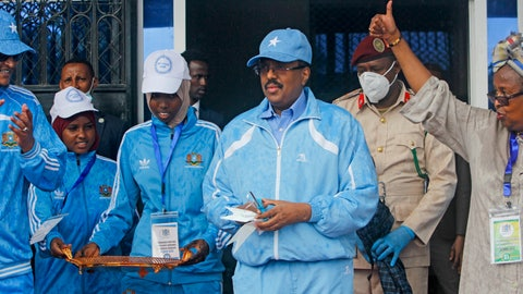 <p>               Somalia's President Mohamed Abdullahi Mohamed, center, prepares to cut the ribbon for the reopening of the stadium in Mogadishu, Somalia Tuesday, June 30, 2020. At least three mortar blasts struck the Mogadishu Stadium Tuesday evening, just hours after it was reopened by Somalia's President Mohamed Abdullahi Mohamed, who had left before the shells hit, following years of instability. (AP Photo/Farah Abdi Warsameh)             </p>
