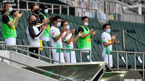 <p>               Moenchengladbach alternate players wearing face masks applaud during the German Bundesliga soccer match between Borussia Moenchengladbach and Union Berlin in Moenchengladbach, Germany, Sunday, May 31, 2020. The German Bundesliga becomes the world's first major soccer league to resume after a two-month suspension because of the coronavirus pandemic. (AP Photo/Martin Meissner, Pool)             </p>