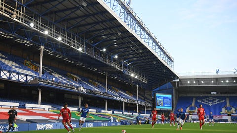 <p>               Players in action in front of the empty stands during the English Premier League soccer match between Everton and Liverpool at Goodison Park in Liverpool, England, Sunday, June 21, 2020. (AP photo/Shaun Botterill, Pool)             </p>