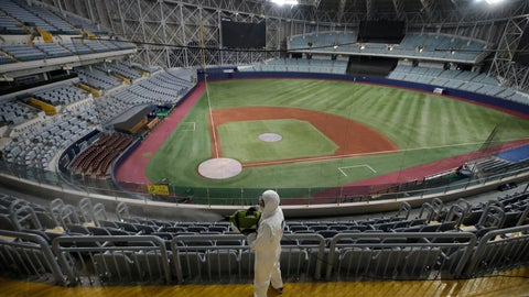 <p>               FILE - In this March 17, 2020 file photo, a worker wearing protective gears disinfects as a precaution against the new coronavirus at Gocheok Sky Dome in Seoul, South Korea. South Korea's professional baseball league said on Tuesday, June 30, it will require fans to wear masks and to sit at least a seat apart as it prepares to bring back spectators in the coming weeks amid the coronavirus pandemic.(AP Photo/Lee Jin-man, File)             </p>