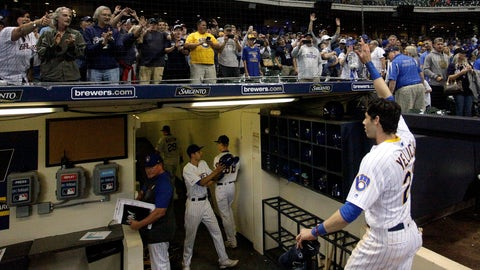 <p>               FILE - In this Sept. 7, 2019, file photo, fans cheer as Milwaukee Brewers' Christian Yelich walks off the field after driving in the winning run with a double during the ninth inning of the team's baseball game against the Chicago Cubs in Milwaukee. Major League Baseball players and owners are currently caught in a bitter dispute over how to start amid the coronavirus pandemic. Both sides occasionally mention fans, talking about doing right by them. (AP Photo/Aaron Gash, File)             </p>