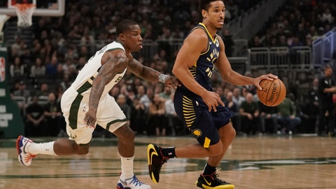 <p>               Indiana Pacers' Malcolm Brogdon drives past Milwaukee Bucks' Eric Bledsoe during the first half of an NBA basketball game Wednesday, March 4, 2020, in Milwaukee. (AP Photo/Morry Gash)             </p>