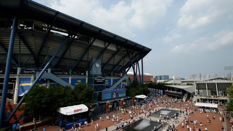 <p>               FILE - In this Aug. 27, 2018, file photo, fans walk outside of Arthur Ashe Stadium during the first round of the U.S. Open tennis tournament in New York. Governor Andrew Cuomo announced, Tuesday, June 16, 2020, that the U.S. Open will be played in Queens from Aug. 31 to Sept. 13, but without fans in attendance. (AP Photo/Jason DeCrow, File)             </p>