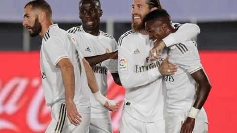 <p>               Real Madrid's Vinicius Junior, right, celebrates after scoring the opening goal with teammates during the Spanish La Liga soccer match between Real Madrid and Mallorca at Alfredo di Stefano stadium in Madrid, Spain, Wednesday, June 24, 2020. (AP Photo/Bernat Armangue)             </p>