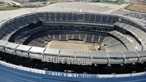 <p>               FILE - In this April 6, 2020, file photo, an empty MetLife Stadium in East Rutherford, N.J. , is viewed. Timing favored the NFL over other major pro sports leagues in trying to figure out how to keep the coronavirus pandemic from wrecking the 2020 season. America's most popular sport has another big advantage if the games are played: TV money. While NFL owners could lose billions collectively with limited capacities in stadiums or no fans at all, the league is well-positioned financially because of lucrative media contracts approaching $10 billion in a full 2020 season. (AP Photo/Ted Shaffrey, File)             </p>