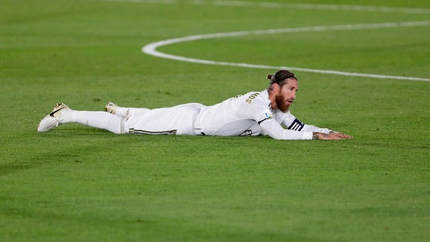 <p>               Real Madrid's Sergio Ramos lies on the field during the Spanish La Liga soccer match between Real Madrid and Valencia at Alfredo di Stefano stadium in Madrid, Spain, Thursday, June 18, 2020. (AP Photo/Manu Fernandez)             </p>