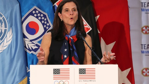 <p>               FILE - In this Aug. 1, 2017, file photo, then-U.S. Olympic Committee chief marketing officer Lisa Baird speaks about the Team USA WinterFest for the upcoming 2018 Pyeongchang Winter Olympic Games, at Yongsan Garrison, a U.S. military base in Seoul, South Korea. Baird assumed her new role as commissioner of the National Women's Soccer League on March 10. Two days later, she shut down the league because of coronavirus. It's certainly not the way she imagined her first 48 hours on the job would go. (AP Photo/Lee Jin-man, File)             </p>