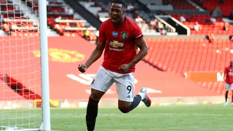 <p>               Manchester United's Anthony Martial celebrates after scoring his side's third goal during the English Premier League soccer match between Manchester United and Sheffield United at Old Trafford in Manchester, England, Wednesday, June 24, 2020. (Michael Steele/Pool via AP)             </p>