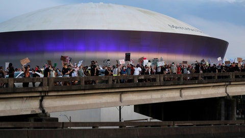 <p>               Protesters take over the elevated Interstate 10 during a march in New Orleans, Tuesday, June 2, 2020, protesting the death of George Floyd, who died May 25 in Minneapolis after being restrained by police. In the background is the Superdome. (AP Photo/Gerald Herbert)             </p>