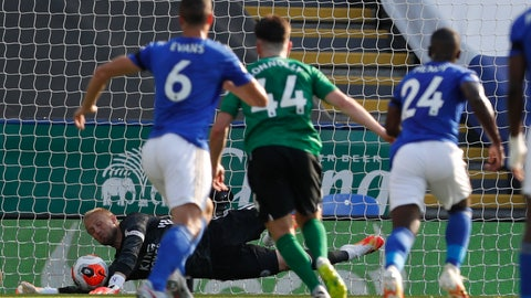 <p>               Leicester's goalkeeper Kasper Schmeichel saves a penalty during the English Premier League soccer match between Leicester City and Brighton & Hove Albion at the King Power Stadium, in Leicester, England, Tuesday, June 23, 2020. (Darren Staples/Pool via AP)             </p>