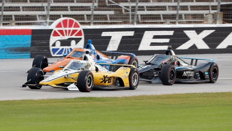 <p>               Josef Newgarden, front, Scott Dixon, rear, and Felix Rosenqvist, right, race down the front stretch during an IndyCar auto race at Texas Motor Speedway in Fort Worth, Texas, Saturday, June 6, 2020. (AP Photo/Tony Gutierrez)             </p>