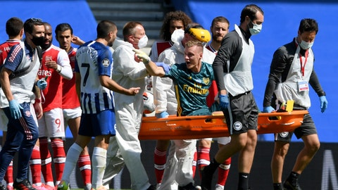 <p>               Arsenal's goalkeeper Bernd Leno gestures at Brighton's Neal Maupay as he leaves the pitch on a stretcher after getting injured during the English Premier League soccer match between Brighton & Hove Albion and Arsenal at the AMEX Stadium in Brighton, England, Saturday, June 20, 2020. (Mike Hewitt/Pool via AP)             </p>