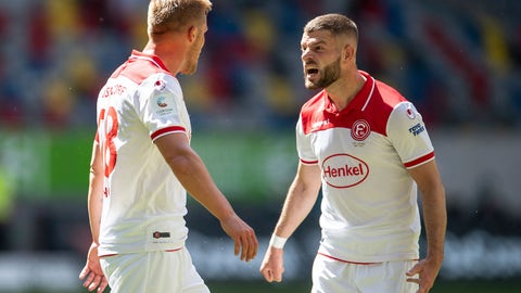 <p>               Duesseldorf's Rouwen Hennings, left, celebrates with Valon Berisha after he scores his side first goal during the German Bundesliga soccer match between Fortuna Duesseldorf and FC Augsburg in Duesseldorf, Germany, Saturday, June 20, 2020. (Marius Becker/Pool via AP)             </p>