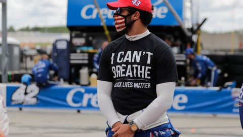 """<p>               Bubba Wallace (43) wears a """"I Can't Breath, Black Lives Matter"""" shirt before a NASCAR Cup Series auto race at Atlanta Motor Speedway, Sunday, June 7, 2020, in Hampton, Ga. (AP Photo/Brynn Anderson)             </p>"""