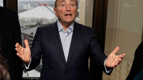 <p>               FILE - In this Jan. 9, 2019, file photo, with KeyArena over his shoulder in the window at left, NHL Commissioner Gary Bettman talks to visitors at a luncheon prior to a news conference in Seattle. It's been over three months since the commissioners of major sports cancelled or postponed events because of the coronavirus. Enough time for us to grade them on how they've handled the virus so far. (AP Photo/Ted S. Warren, File)             </p>