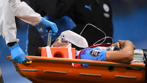<p>               Manchester City's Eric Garcia leaves the field injured during the English Premier League soccer match between Manchester City and Arsenal at the Etihad Stadium in Manchester, England, Wednesday, June 17, 2020. The English Premier League resumes Wednesday after its three-month suspension because of the coronavirus outbreak. (Laurence Griffiths/Pool via AP)             </p>