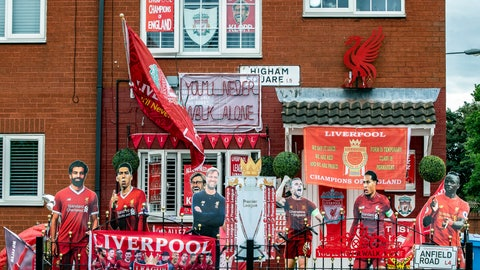 <p>               A view of a house in Merseyside decorated with Liverpool FC memorabilia, as Jurgen Klopp's team take a step closer to winning the Premier League title, in Liverpool, England, Monday June 22, 2020. (Peter Byrne/PA via AP)             </p>
