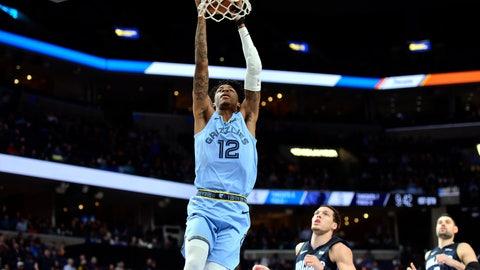 <p>               Memphis Grizzlies guard Ja Morant (12) dunks ahead of Orlando Magic forward Aaron Gordon (00) and center Nikola Vucevic (9) during the first half of an NBA basketball game Tuesday, March 10, 2020, in Memphis, Tenn. (AP Photo/Brandon Dill)             </p>
