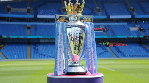 """<p>               FILE - In this Sunday, May 6, 2018 file photo, the English Premier League trophy is displayed on the pitch prior to the English Premier League soccer match between Manchester City and Huddersfield Town at Etihad stadium in Manchester, England. A Bournemouth player is one of two positive tests for COVID-19 to emerge from the Premier League's second round of testing, the club said on Sunday, May 24, 2020. The team said """"medical confidentiality means the player's name will not be disclosed"""" and added that he will self-isolate for seven days before being tested again at a later date. The league tested 996 players and club staff on Tuesday, Thursday, and Friday.  (AP Photo/Rui Vieira, File)             </p>"""