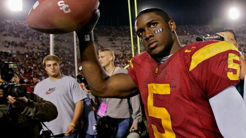 "<p>               FILE - In this Nov. 19, 2005, file photo, Southern California tail back Reggie Bush walks off the field holding the game ball after the Trojans defeated Fresno State, 50-42, at the Los Angeles Coliseum. The former star running back had been prohibited from interacting in an official capacity with the school he played for from 2003-05 since NCAA sanctions handed down in 2010. Bush and USC were penalized for him and his family receiving impermissible benefits while he was still in school. USC President Carol Folt wrote in a letter to Bush on Wednesday, June 10, 2020, that he could now ""be afforded the privileges and courtesies extended to all Trojan football alums.""(AP Photo/Kevork Djansezian, File)             </p>"