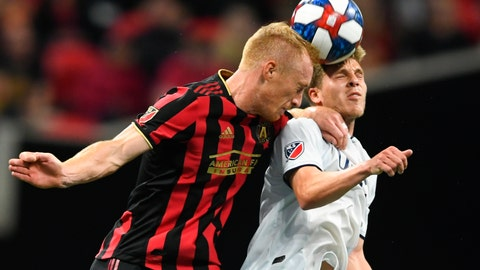 """<p>               FILE - In this Oct. 19, 2019, file photo, Atlanta United defender Jeff Larentowicz, left, and New England Revolution midfielder Scott Caldwell battle for a header during round one of an MLS Cup playoff soccer game in Atlanta. Atlanta United veteran defender Jeff Larentowicz, who serves as an executive board member for the players union, said Thursday, June 4, 2020, he has safety concerns about an agreement announced Wednesday for a MLS tournament in Orlando in July. He is worried about the ongoing coronavirus pandemic and said """"We play a contact sport and the virus is a serious thing that puts us all in danger."""" (AP Photo/John Amis, File)             </p>"""