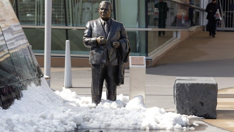 <p>               FILE - In this April 17, 2014, file photo, a statue of former Twins' owner Calvin Griffith stands in the snow outside Target Field before a baseball game between the Minnesota Twins and the Toronto Blue Jays in Minneapolis. The Twins say they've removed a statue of former owner Calvin Griffith at Target Field, citing racist remarks he made in 1978. (AP Photo/Paul Battaglia, File)             </p>