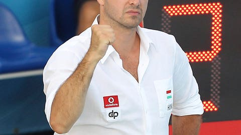 <p>               In this July 28, 2013 photo the head coach of the Hungarian national water polo team Tibor Benedek gestures during the men's water polo Hungary vs. Kazakhstan round of 16 match in Barcelona, Spain. Tibor Benedek, with three Olympic titles, who won both a European Championship and World Championship as a player, collecting four world and seven continental medals in total, died on Thursday, June 18, 2020, at the age of 47 years. (Aniko Kovacs/MTI via AP)             </p>