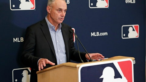 """<p>               FILE - In this Feb. 6, 2020, file photo, Baseball Commissioner Rob Manfred answers questions at a press conference during baseball owners meetings in Orlando, Fla. Manfred tells The Associated Press that the commissioner's office, teams and the players' association """"owe it to our fans to be better than we've been the last three months."""" (AP Photo/John Raoux, File)             </p>"""