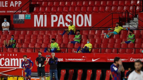 <p>               Barcelona's head coach Quique Setien, center left, gestures during the Spanish La Liga soccer match between Sevilla and FC Barcelona at the Ramon Sanchez-Pizjuan stadium in Seville, Spain, Friday, June 19, 2020. (AP Photo/Angel Fernandez)             </p>
