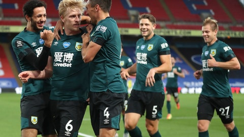 <p>               Burnley's Ben Mee, second left, is congratulated by teammates after scoring his team's first goal during the English Premier League soccer match between Crystal Palace and Burnley at Selhurst Park, in London, England, Monday, June 29, 2020. (AP Photo/Catherine Ivill,Pool)             </p>